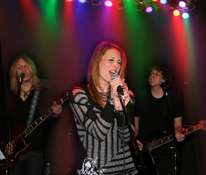 Christy Angeletti on stage with her band